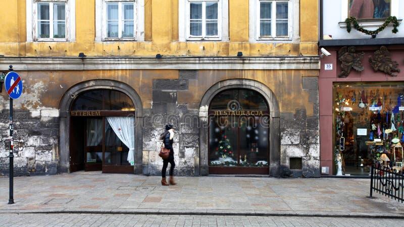 Shopping in Krakow in Christmas time. Jung girl does shopping in Krakow in Christmas time stock photography