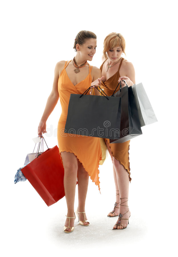 Shopping ladies. Happy ladies with shopping bags royalty free stock image