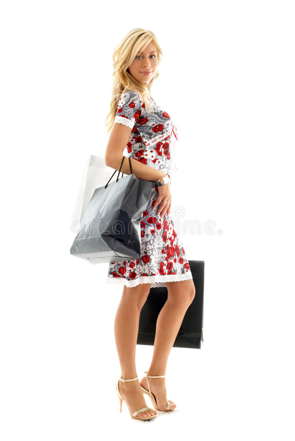 Shopping lady. Lovely blond with shopping bags over white stock photography