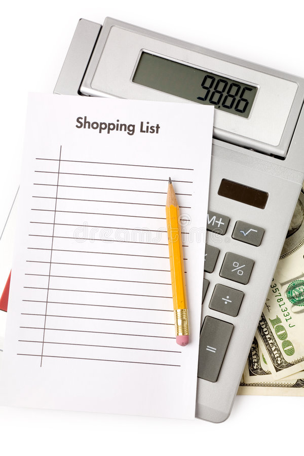Shopping List and calculator royalty free stock photo