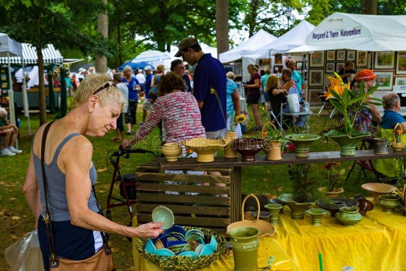 Shopping at the Lititz Outdoor Fine Art Show stock photos
