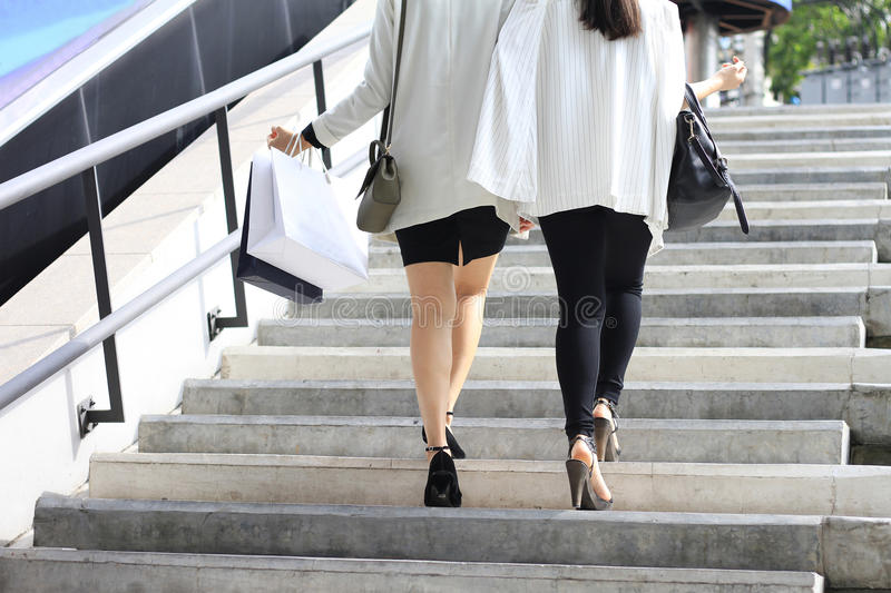 Shopping lover, Women holding shopping bags on the street. stock photography