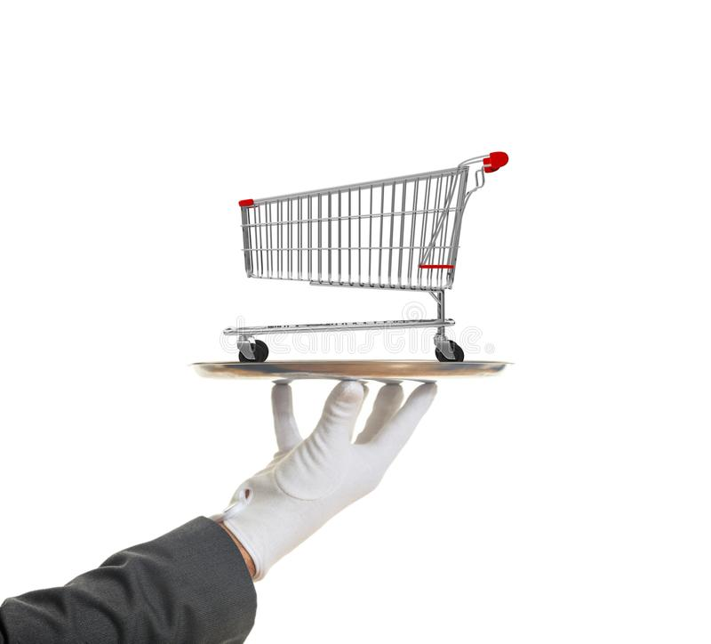 Gloved hand holding a silver platter with an empty shopping trolley, isolated on white background. 3d illustration. Shopping luxury service concept. Gloved hand royalty free stock image