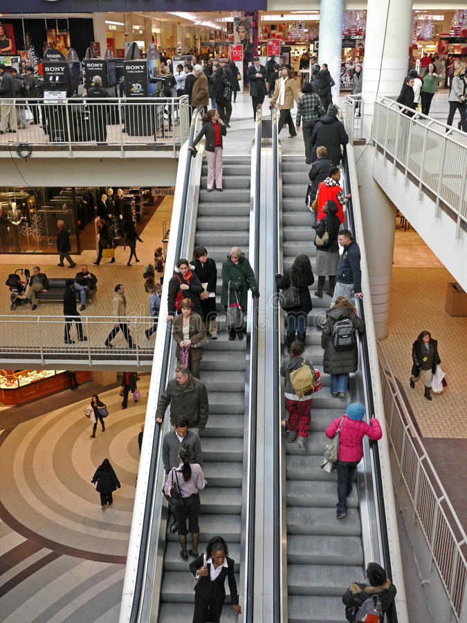 Shopping mall escalator. The multi-level indoor mall is a popular form of shopping in North American suburbs stock photography