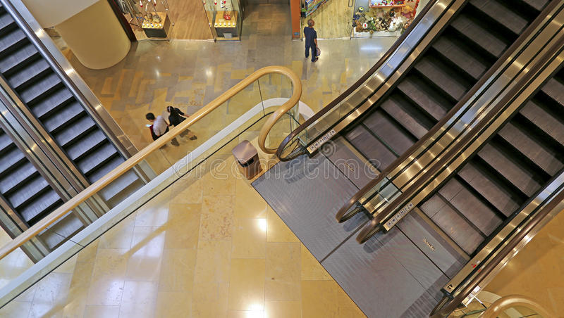 Shopping mall escalators. Over view of escalators at pacific place shopping mall in hong kong royalty free stock photo