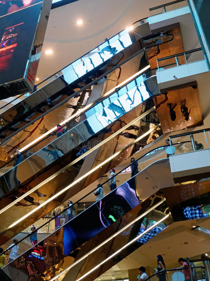 Shopping Mall Escalators. Reflective multi-level escalators, travelators or moving stairs, in a modern shopping centre or mall stock images