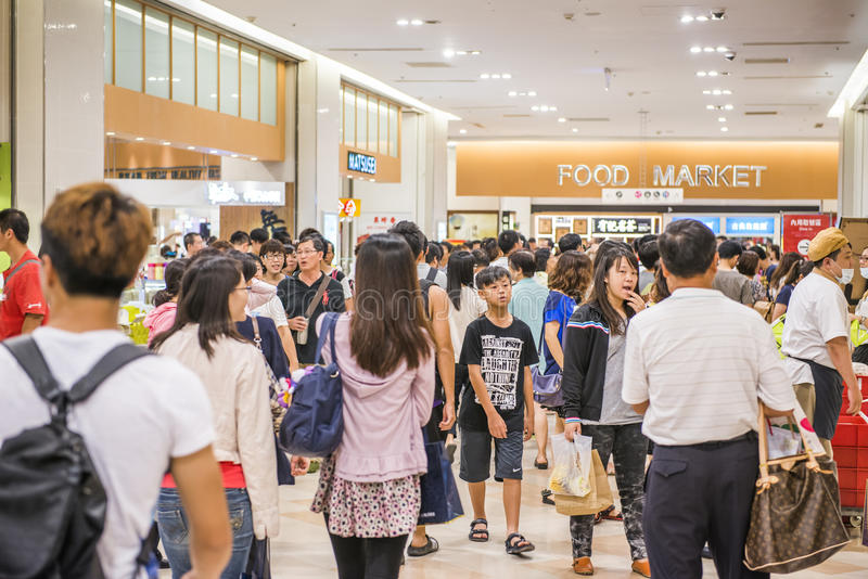 Shopping mall. KAOHSIUNG - TAIWAN, 16 FEBRUARY 2014:Taiwan has many large department stores, a lot of people will come to this holiday shopping to buy things to royalty free stock image