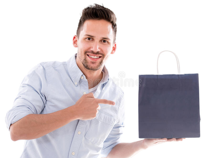 Download Shopping Man Pointing At A Bag Stock Image - Image of people, cheerful: 32215271