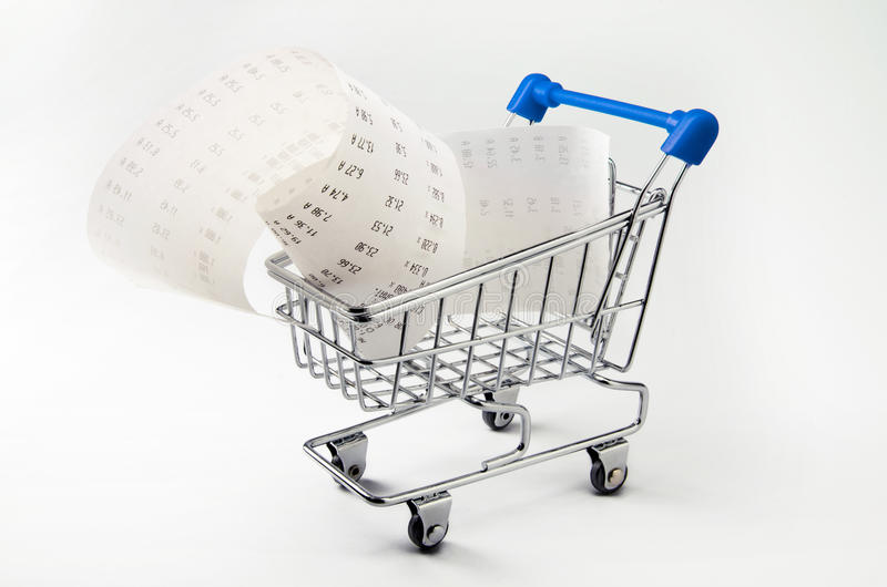 Shopping money. Receipt and calculator in shopping trolley stock images