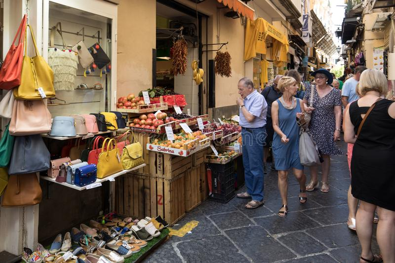 Shopping in the narrow streets of Sorrento, near Naples, Italy stock images
