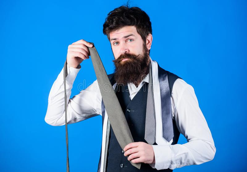 Shopping for necktie. Hipster shopping the latest tie collection. Shop assistant offering broad assortment of neckties stock photos