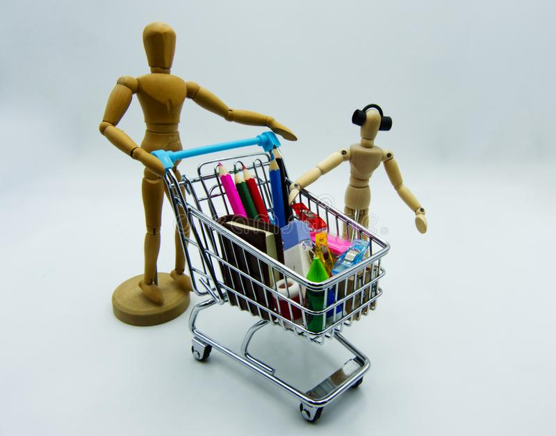 Shopping for the new school year. Painter`s wooden models on white background royalty free stock photo