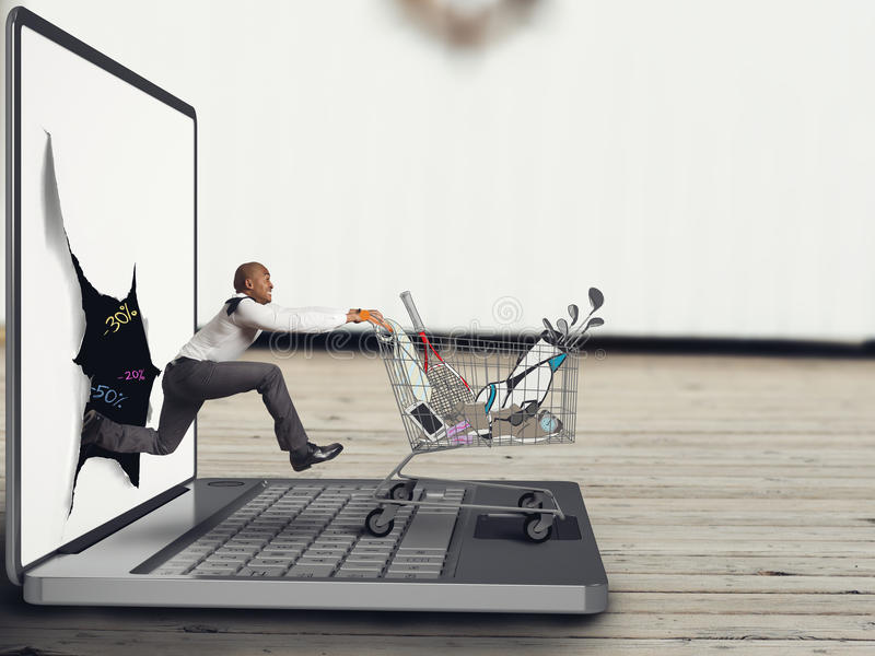 Shopping online. Businessman pushes a Shopping cart on the keyboard of laptop stock photos
