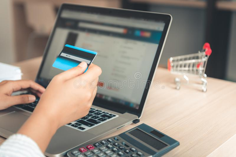 Shopping online concept, Close up woman hand holding credit card royalty free stock photos