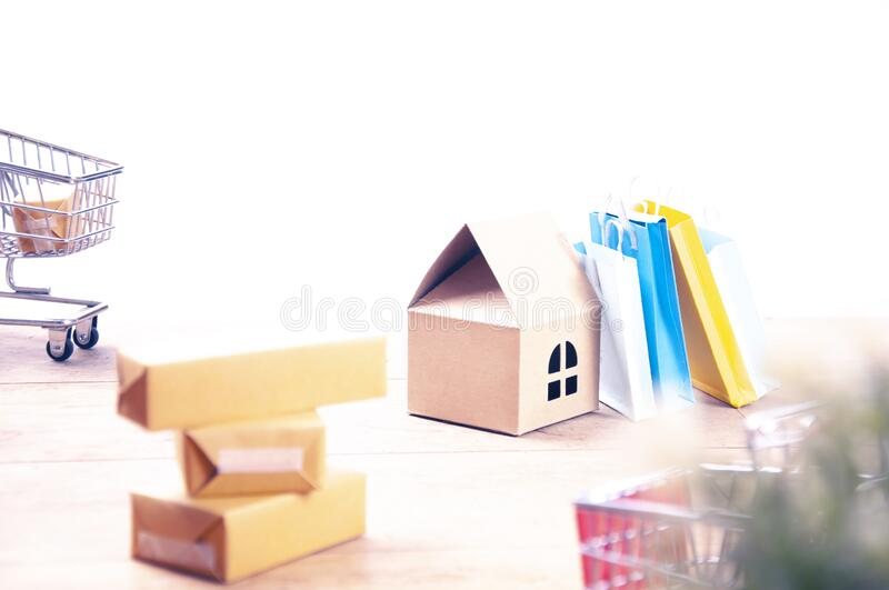 E-Commerce. Items representing e-commerce or online shopping and global delivery stock image