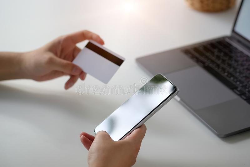 Shopping online with credit card and smartphone royalty free stock image