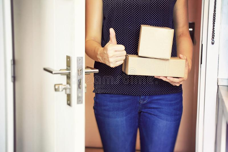 Shopping online, E business, Trend of modern business. Hand holding boxes at the front door, Receiving package from parcels delivery service, Good condition stock image