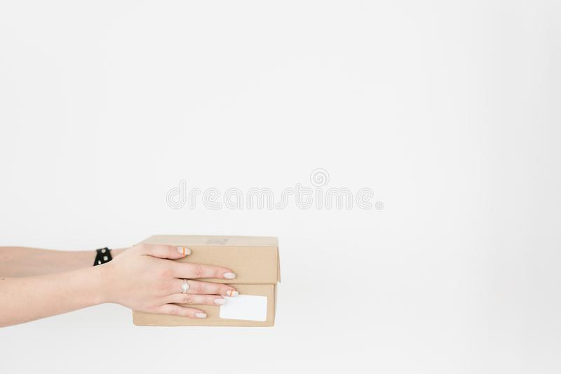 Shopping online goods delivery hands holding box stock photography