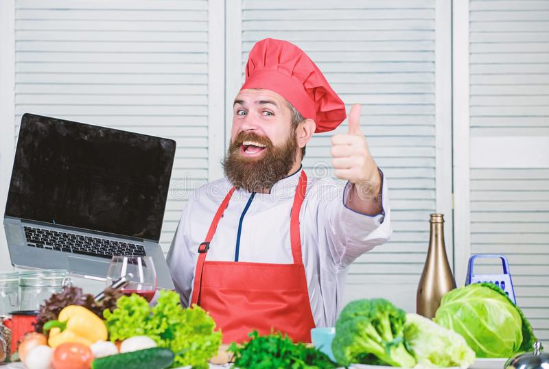 Shopping online. Man chef searching online ingredients cooking food. Grocery shop online. Delivery service. Chef laptop. At kitchen. Culinary school. Hipster in royalty free stock images