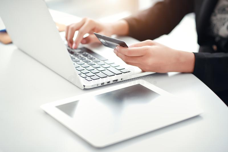 Shopping and online payment by using laptop computer and tablet with credit card. Businesswoman hands shopping and online payment by using laptop computer and royalty free stock photo