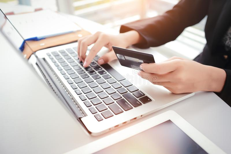 Shopping and online payment by using laptop computer and tablet with credit card. Businesswoman hands shopping and online payment by using laptop computer and stock photos
