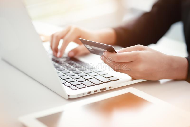 Shopping and online payment by using laptop computer and tablet with credit card. Businesswoman hands shopping and online payment by using laptop computer and stock photography