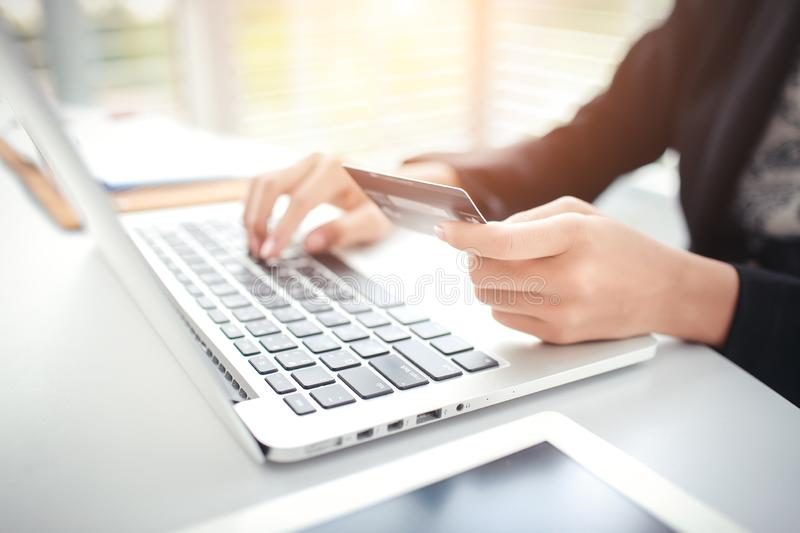 Shopping and online payment by using laptop computer and tablet with credit card. Businesswoman hands shopping and online payment by using laptop computer and stock image