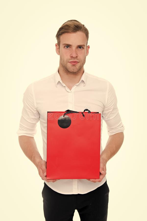 Shopping online. Purchase delivery. Businessman use shopping application. Man carries shopping bag white background stock image