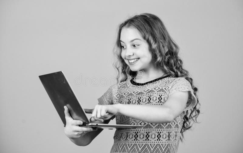 Shopping online. school project. happy small girl with notebook. child development in digital age. video call by web cam. Home schooling education. business stock photo