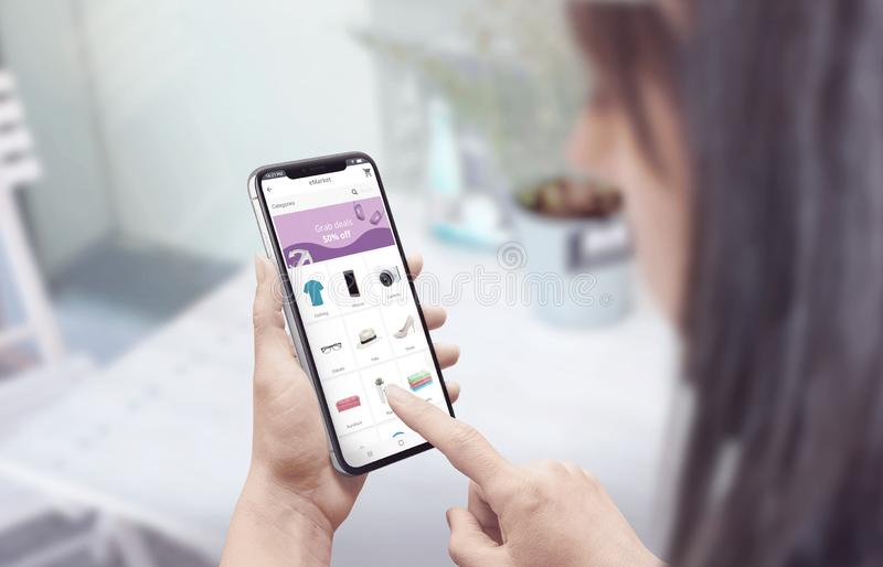 Shopping online with a smartphone. modern flat design web site or app concept stock photos