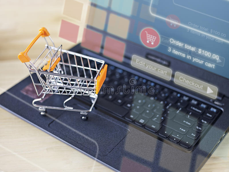 Shopping online. Toy shopping cart on keyboard of laptop computer for online shopping and e-commerce concept stock photos