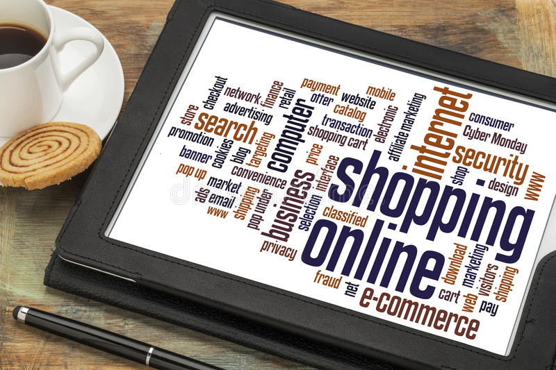 Shopping online word cloud. On a digital tablet with a cup of coffee royalty free stock photos