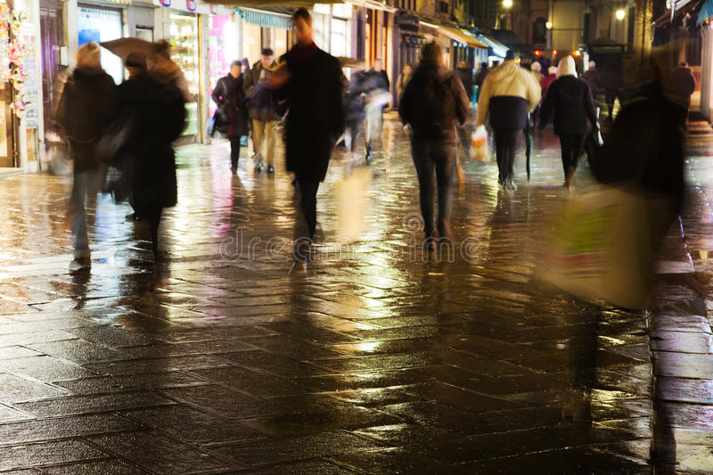 Shopping people at night in venice. People shopping at night in venice royalty free stock photos