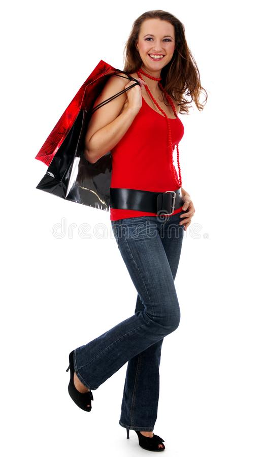 Shopping pretty woman over white background stock image