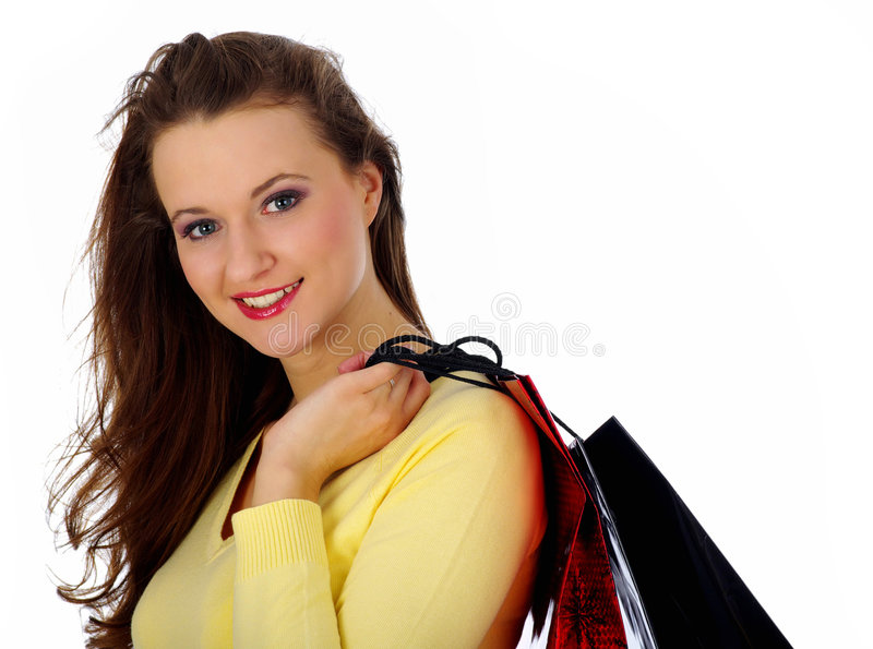 Shopping pretty woman over white background.  stock images