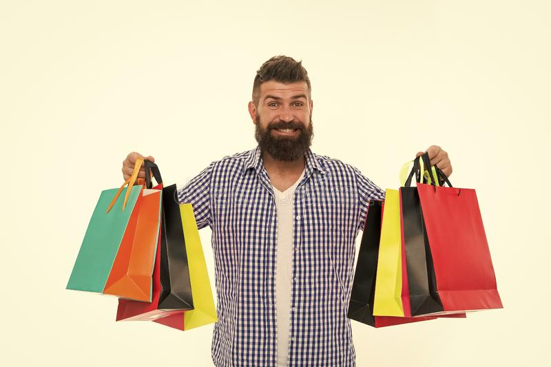 Shopping sale. Male barber care. Bearded man with shopping bags.. Black Friday. Cyber Monday. Mature happy hipster with royalty free stock image