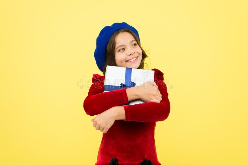 In shopping store. school fall season. happy small girl with present box. small girl hold holiday gift. happy birthday stock photography