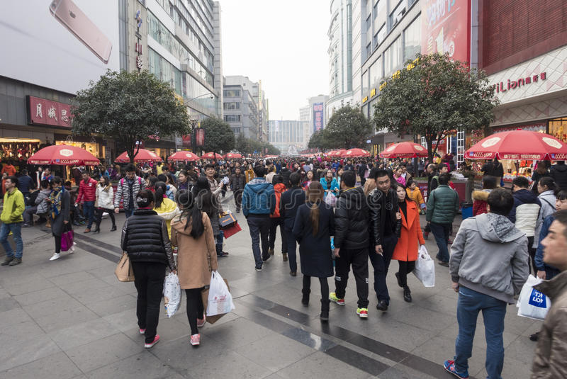 Shopping street .chengdu. Shoppers and visitors crowd at a shopping street ,chunxi street,chinese famous business walking street in chengdu stock image