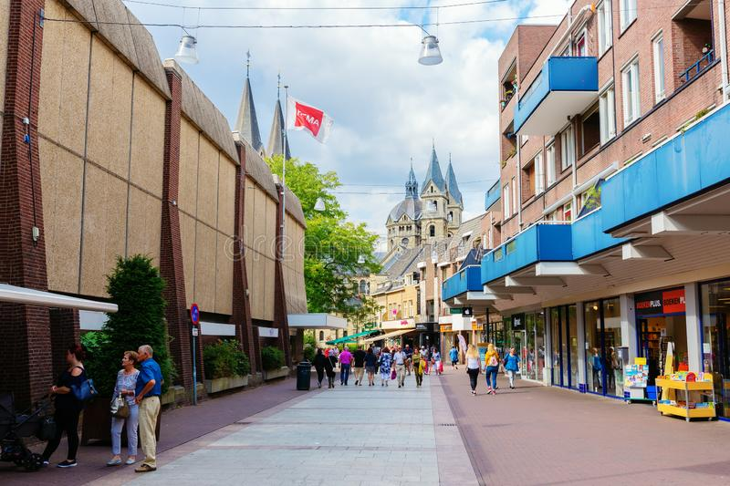 Shopping street in the city center of Roermond, Netherlands. Roermond, Netherlands - August 14, 2018: shopping street in the city center of Roermond with royalty free stock image