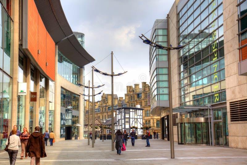 Shopping street in city centre. Pedestrian shopping street in Manchester city centre royalty free stock photos