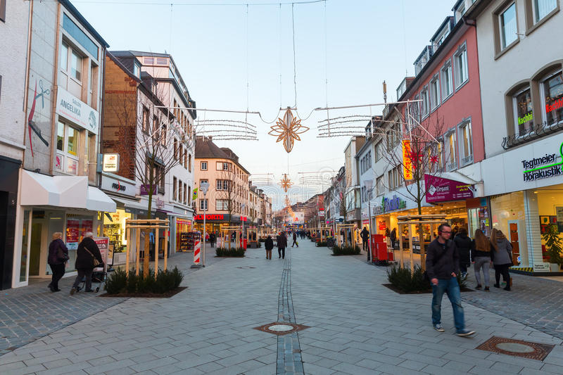 Shopping street in Dueren, Germany. Dueren, Germany - December 28, 2016: christmas decorated shopping street in Dueren with unidentified people. Dueren is stock image