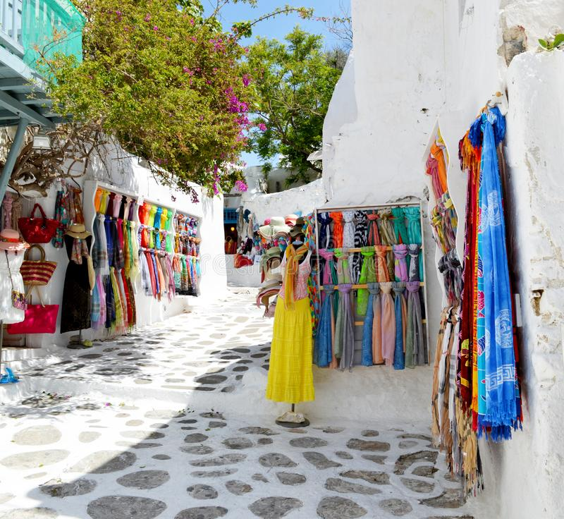 Shopping street at Mykonos. Colorful dress and Scarf. Greece royalty free stock photography