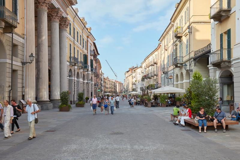 Shopping street via Roma with people walking and historic buildings in Cuneo, Italy stock photo