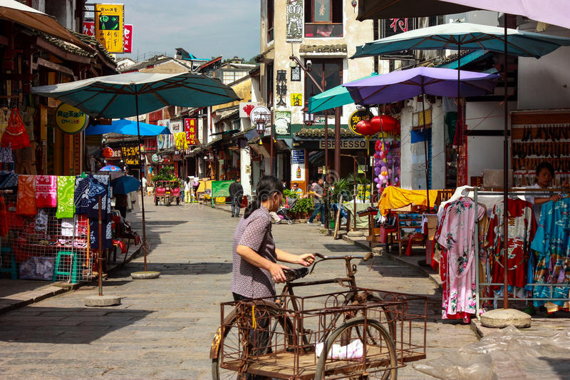 Shopping Street in Yangshuo. Yangshuo County is a county under the jurisdiction of Guilin City, in the northeast of Guangxi, China. Its seat is located in stock photos