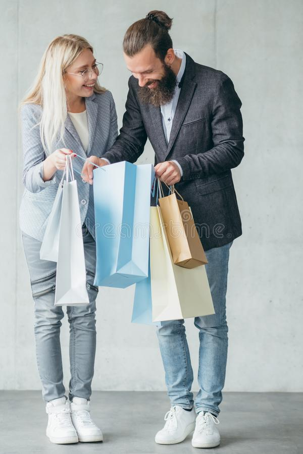 Shopping surprise woman show purchase man bags royalty free stock photography