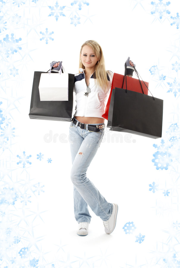 Shopping teenage girl with snowflakes #2. Teenage girl with shopping bags and snowflakes royalty free stock image