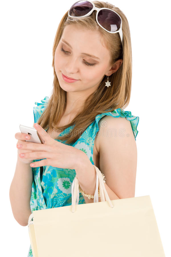 Shopping teenager woman with mobile phone royalty free stock photos