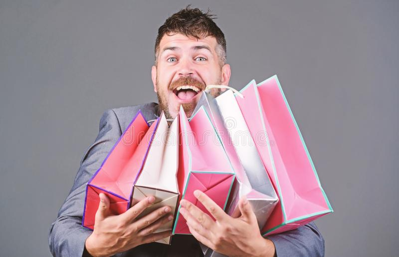 Shopping therapy in action. businessman in bow tie. bearded man in formal suit. heavy bags. Mature shopaholic. stylish stock images
