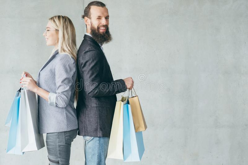 Shopping therapy happy delighted couple hold bags stock images