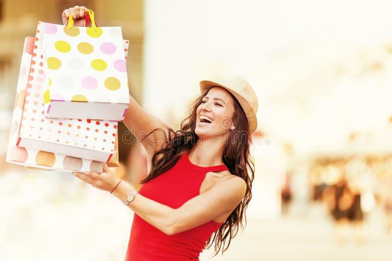 Shopping Time. Beautiful young woman enjoying shopping royalty free stock photography